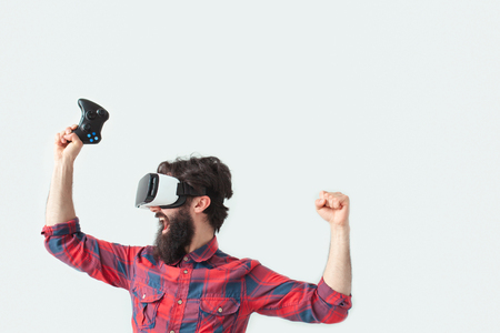 Male in VR headset winning