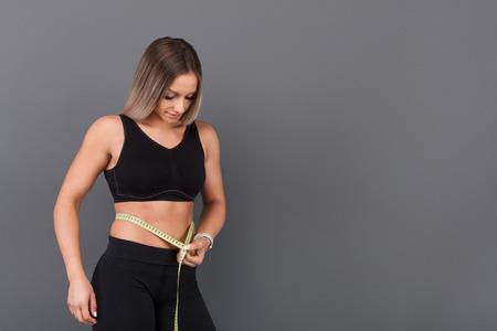 女性測定腰テープ