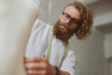 Man creating clothing in studio Stock Photo