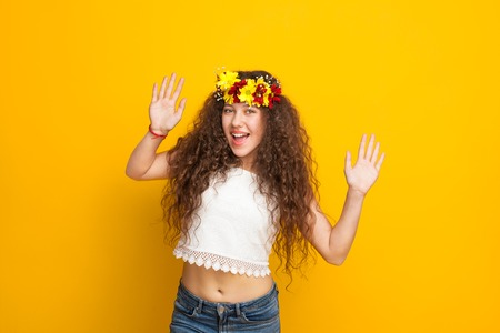 Curly haired girl wearing chaplet