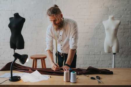 Man creating new clothes in parlour