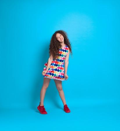 Stylish woman in bright dress Stock Photo