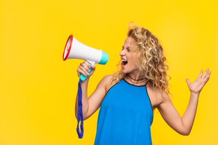 Expressive woman speaking with megaphone
