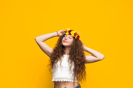 Dreaming girl in floral wreath Stock Photo