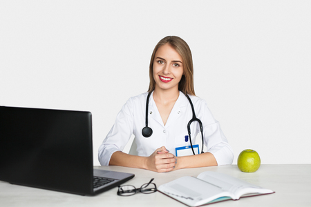 Female doctor sitting at table