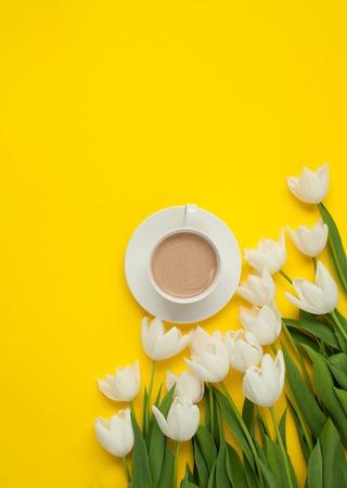 Mug with coffee and white flowers Stock Photo