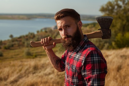 Young hipster man with axe Stock Photo