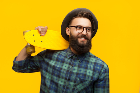 Content man with skate on orange Stock Photo