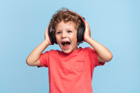 Excited kid posing in headphones