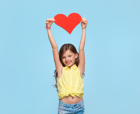 Adorable child with paper heart