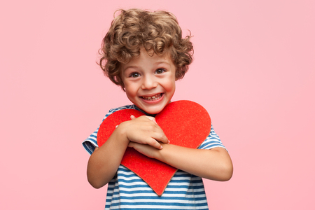 Charming boy posing with heart Stok Fotoğraf - 85488542