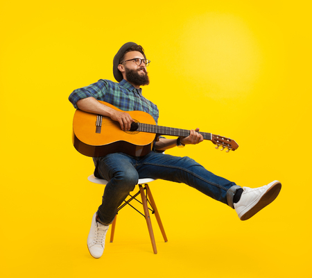 Hipster man with guitar