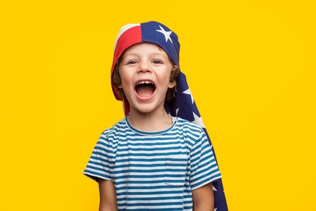 Cheerful kid with flag on head Stock Photo