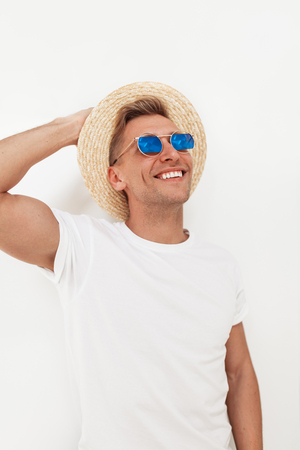 Cheerful hipster man posing on white Stock Photo