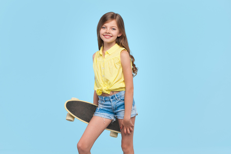 Stylish little girl with longboard