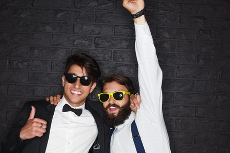 Two men wearing sunglasses posing