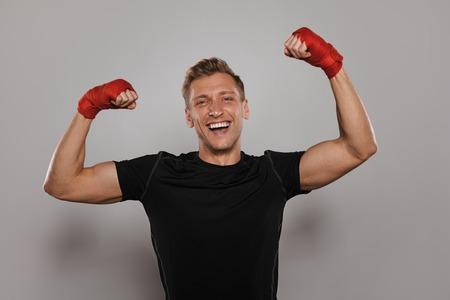 Happy boxer on gray background Reklamní fotografie