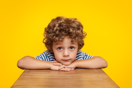 Little boy looking dreamily at camera Stock Photo