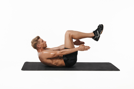 laying abs exercise: Man doing abs exercise in studio