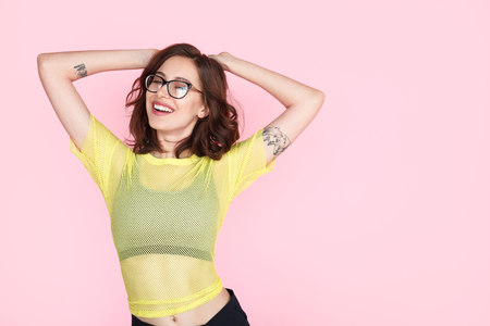Brunette girl in glasses dancing Stock Photo