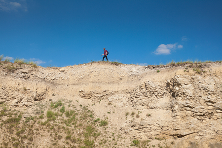 Anonymous man on edge of cliff Stok Fotoğraf