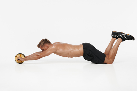 Man exercising abs with roller