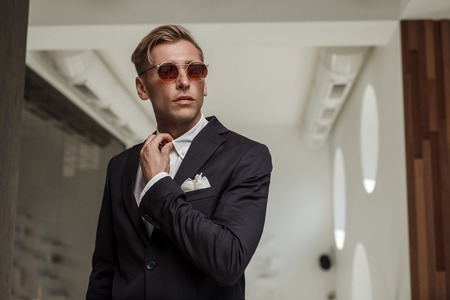 Gentleman in suit and sunglasses