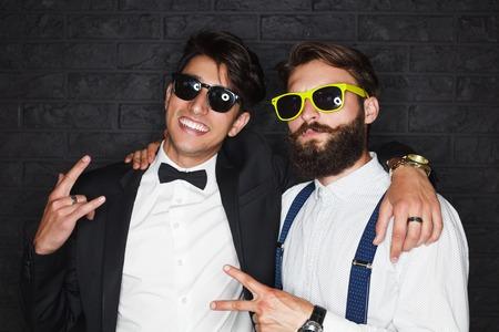 Two elegant men posing happily Reklamní fotografie
