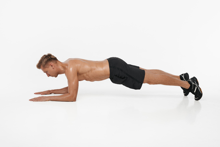 Man leaning on arms and exercising