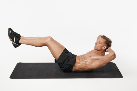 Man performing ab exercise Stock Photo
