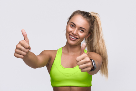 Woman gesturing thumbs up Stock Photo
