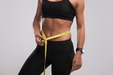 Woman measuring waist Stock fotó