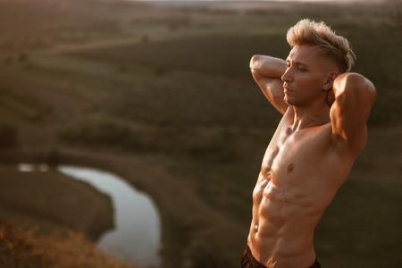 Bare-chested man enjoying weather Stock Photo
