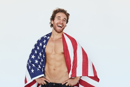 Man covered in USA flag Stock Photo
