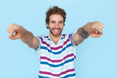 Happy man pointing at camera