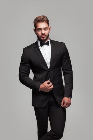 Elegant confident man in tuxedo