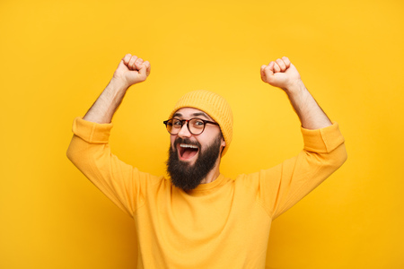 Man in yellow clothes feeling happy