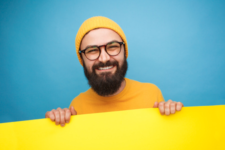 Cheerful man with yellow banner