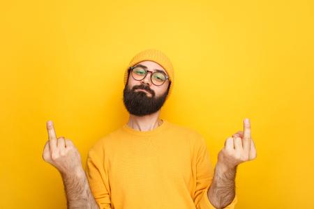 Ignorant man showing obscene gesture