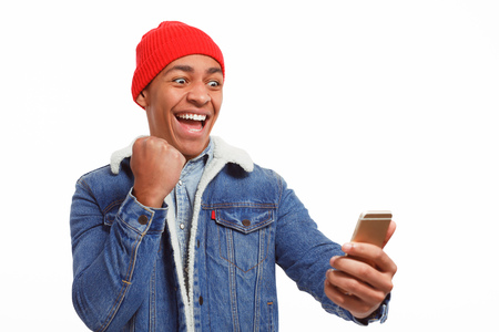 Man holding phone excited with win