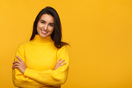 Charming female on yellow backdrop
