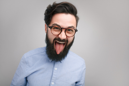 Crazy expressive hipster in glasses