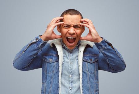 Stressed man in denim screaming
