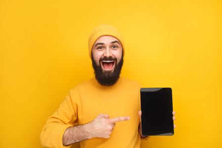 Stylish young man promoting tablet Stock Photo