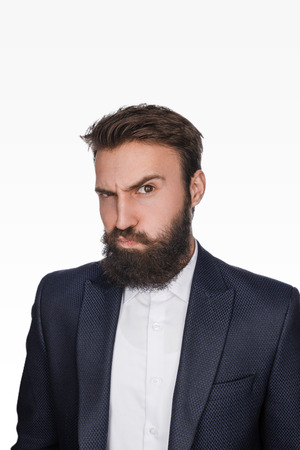 Suspicious bearded man in suit Stock Photo