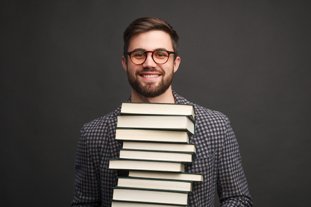 Diligent man with books
