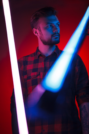Serious man in neon bright lights