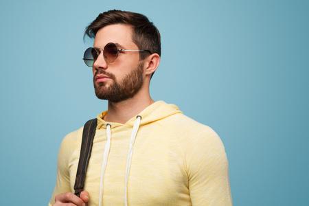 Handsome stylish man on blue