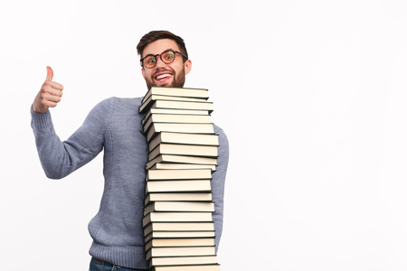 Satisfied student with big stack of books
