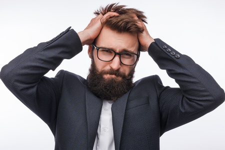 Desperate bearded guy pulling out hair